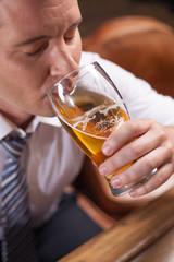 closeup portrait of man drinking beer.