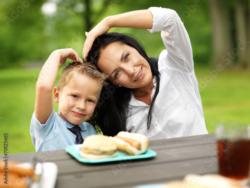 mother and son making heart shape at picnic - 70025665