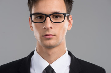 Portrait of mid adult man in glasses.