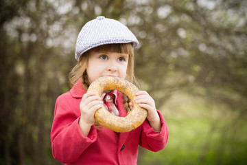 funny girl with donut outdoor