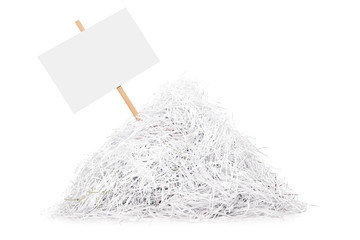 Signboard stuck in a pile of shredded paper