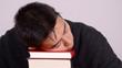 canvas print picture - mann schläft auf büchern
