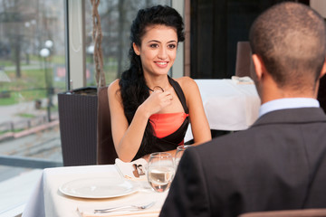 Smiling attractive woman and man having discussion.