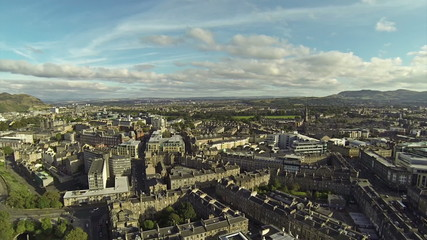 Two scenes of camera flying over Edinbutgh near the castle.