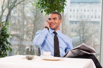 young handsome business man talking on phone.