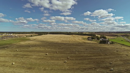 Two scenes of camera flying over bales of hay and very beautiful