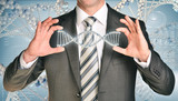 Businessman holding dna spiral in hands