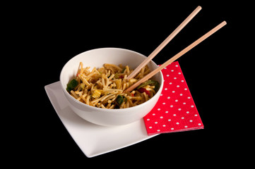 Cantonese noodles in a bowl with chopsticks