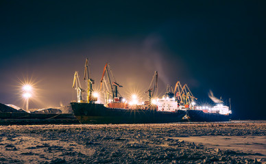 Cargo ship in the northern port at the night
