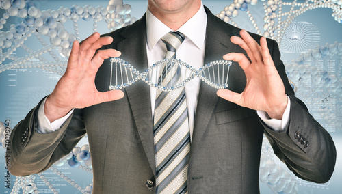 Papiers peints Spirale Businessman holding dna spiral in hands