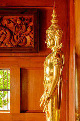 A golden statue of Buddha in a main hall