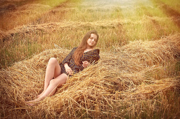 beautiful young brunette girl on the meadow