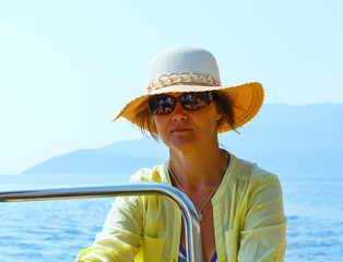 Woman in a motorboat.