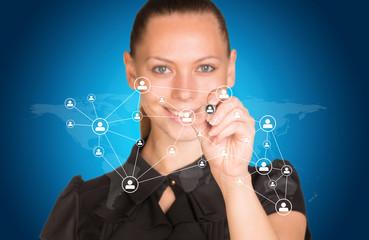 Beautiful businesswoman in dress presses virtual network