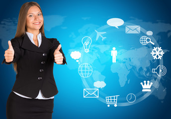 Beautiful businesswoman showing thumbs-up