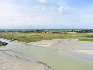 flat tidal bay and pasture near mont saint-michel