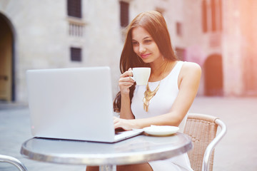Attractive woman working with computer and drink coffee