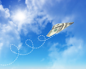 Paper airplanes made of hundred dollar bills