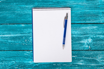 Blank notepad on blue painted wood