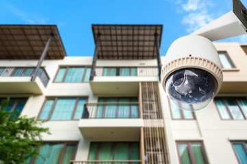 CCTV camera or surveillance operating with apartment in backgrou
