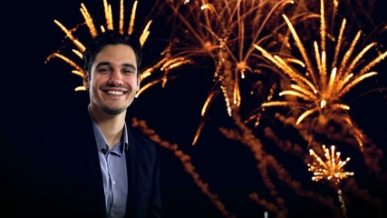 young man enjoying new year's fireworks