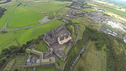 Three scenes of camera flying over Stirling castle in Scotland.