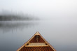 Canoeing on a Misty Lake