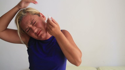 Woman having earache