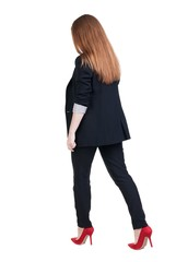 walking red head business woman.