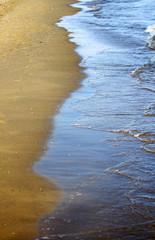 wave on the ocean's sandy beach