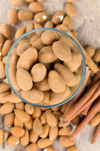 canvas print picture almonds in chocolate with cinnamon