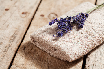 Bouquet of lavender flowers on towel, spa concept