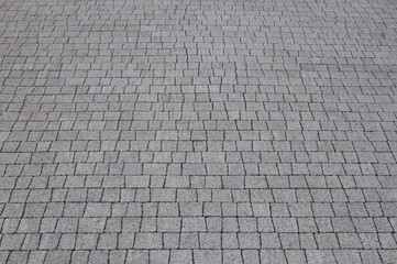 Granite cobblestoned pavement background