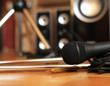 Music microphone wire on the background of the audio system - 70036413