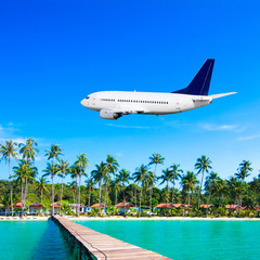 Jet plane over the tropical sea