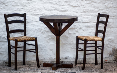 Rustic chairs and a table in Alberobello
