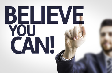 Business man pointing the text: Believe you Can!