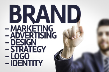 Business man pointing the text: Description of a Brand