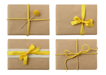 Variety of isolated neutral presents with yellow bow