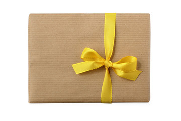 Birthday or xmas gift package wrapped w yellow bow - isolated