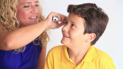 Mother Combing Little Boy's Hair