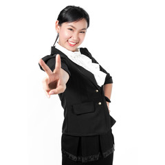 Young business woman showing victory sign with two fingers