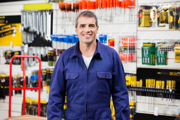 Confident Worker Smiling In Hardware Shop