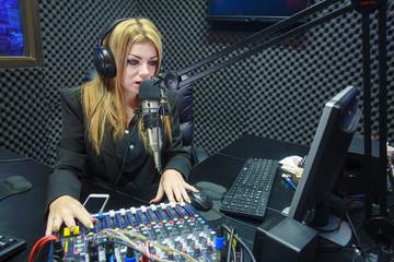 Beautiful Woman Recording Sound In Media Studio