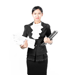 Young pretty business woman holding pile of document and laptop