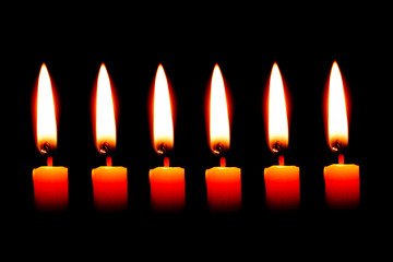 six Candle on black background