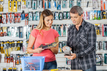Couple Making Electronic Payment In Hardware Store