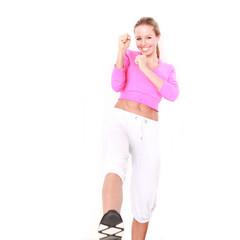 Aufwärmübung einer Sportlerin