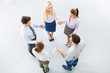 Business people holding hands to form a circle