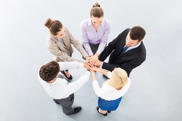 Team placing hands over each others